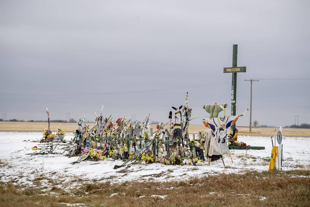 A memorial at the site of the fatal bus crash involving the Humboldt Broncos hockey team stands at the intersection of highways 35 and 335 near Tisdale, Sask., on Tuesday, Oct. 27, 2020. Lawyers for the Saskatchewan government are to be in court today to ask that the province be removed from a lawsuit over the crash. THE CANADIAN PRESS/Liam Richards