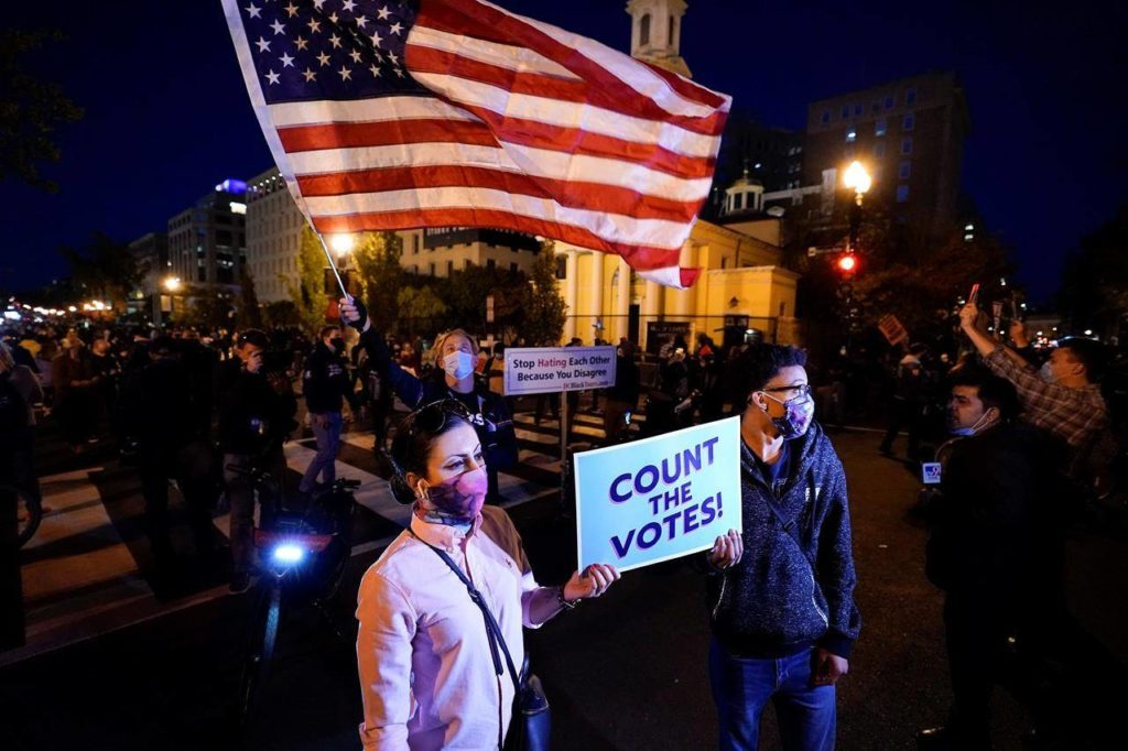Demonstrators gather at Black Lives Matter Plaza to advocate that all votes be counted one day after Election Day, Wednesday, Nov. 4, 2020, in Washington. With his room to manoeuvre rapidly dwinding, President Donald Trump is lashing out with threats of legal action as Joe Biden closes in on the Oval Office. THE CANADIAN PRESS/AP, Alex Brandon