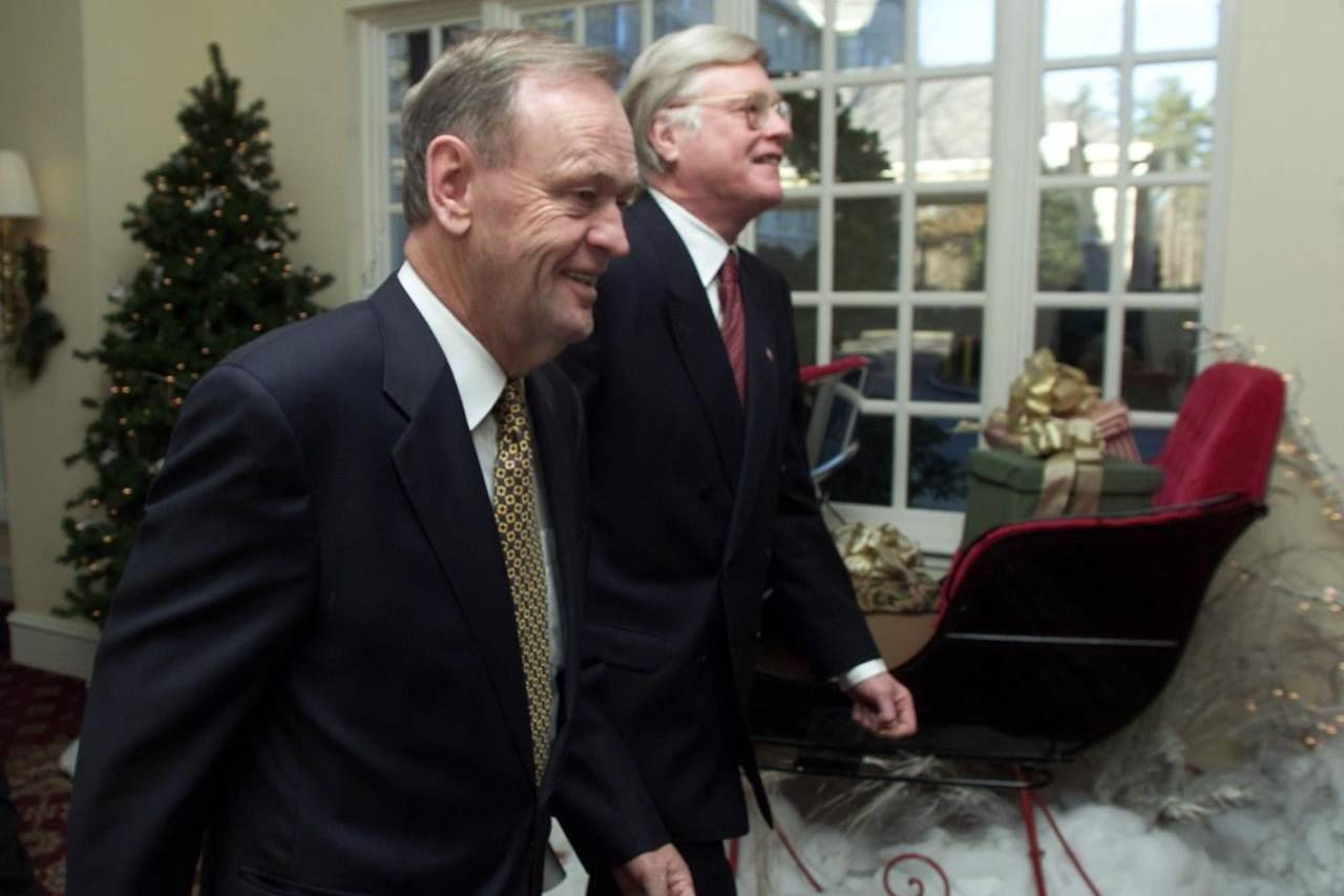 Canadian Prime Minister Jean Chretien, left, and Canadian ambassador to the U.S. Michael Kergin walk past a Christmas display on their way to a breakfast meeting with business leaders in Durham, N.C. on Monday Dec. 4, 2000. The last time a U.S. presidential election ended in uncertainty, the Canadian government adopted a policy of saying nothing until all the votes were counted and legal challenges resolved. THE CANADIAN PRESS/Frank Gunn