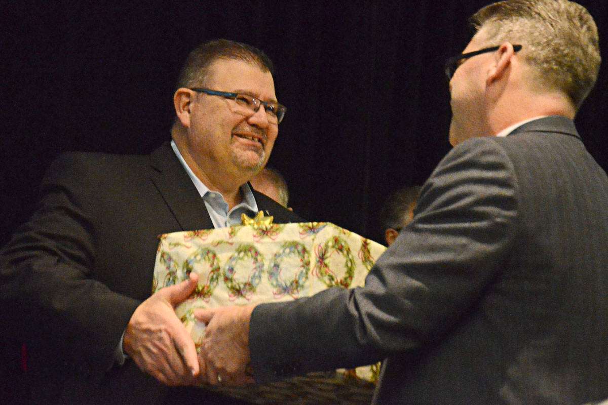 Gus Hartl, left, accepted a gift from Greater Langley Chamber of Commerce past president Jack Nicholson as it was announced Hartl was the 2019 recipient of the H.D. Stafford Good Citizen of the Year honour. (Langley Advance Times files)