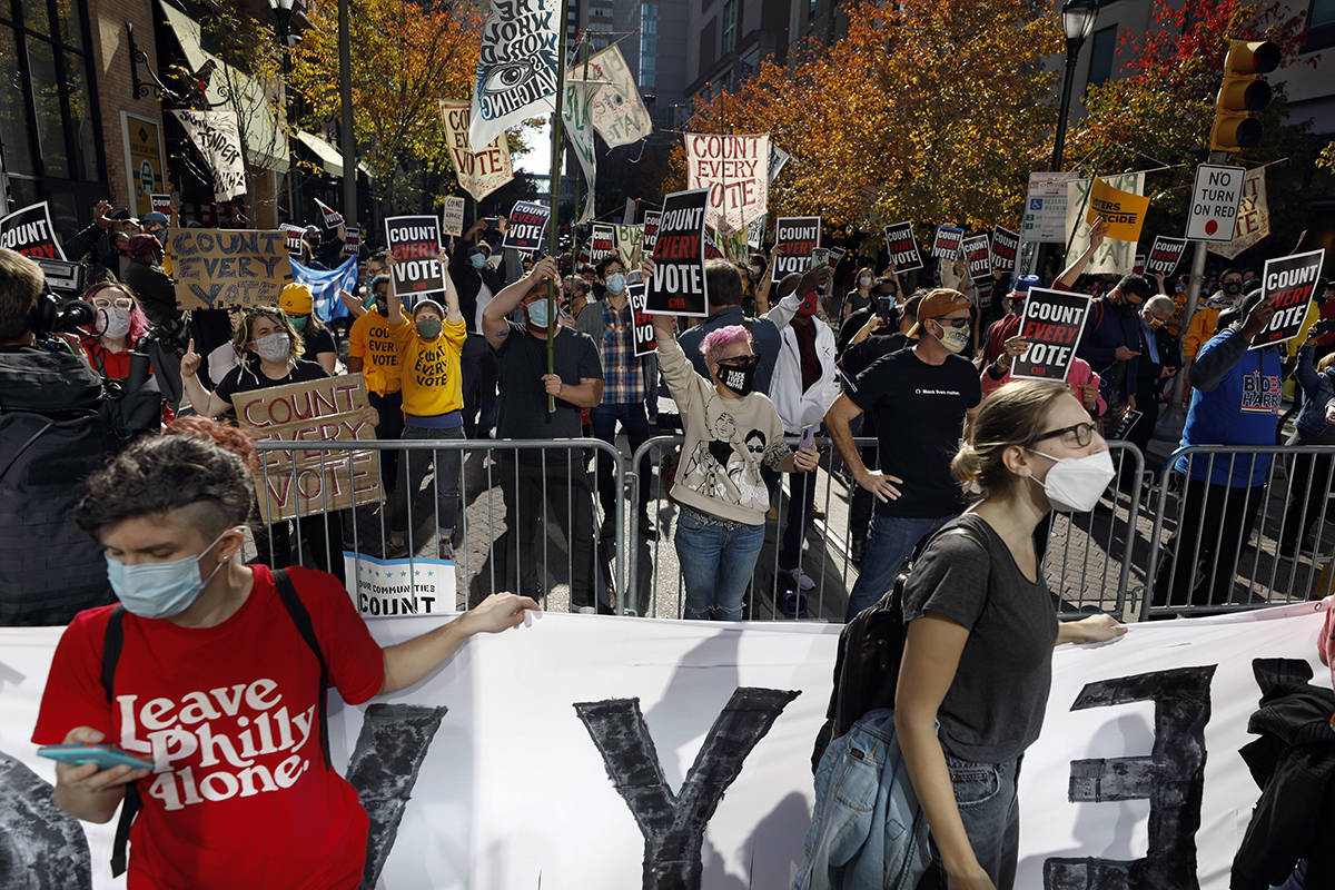 Demonstrators call for all votes be counted as they demonstrate outside the Pennsylvania Convention Center, Thursday, Nov. 5, 2020, in Philadelphia, as vote counting in the general election continues. (AP Photo/Rebecca Blackwell)