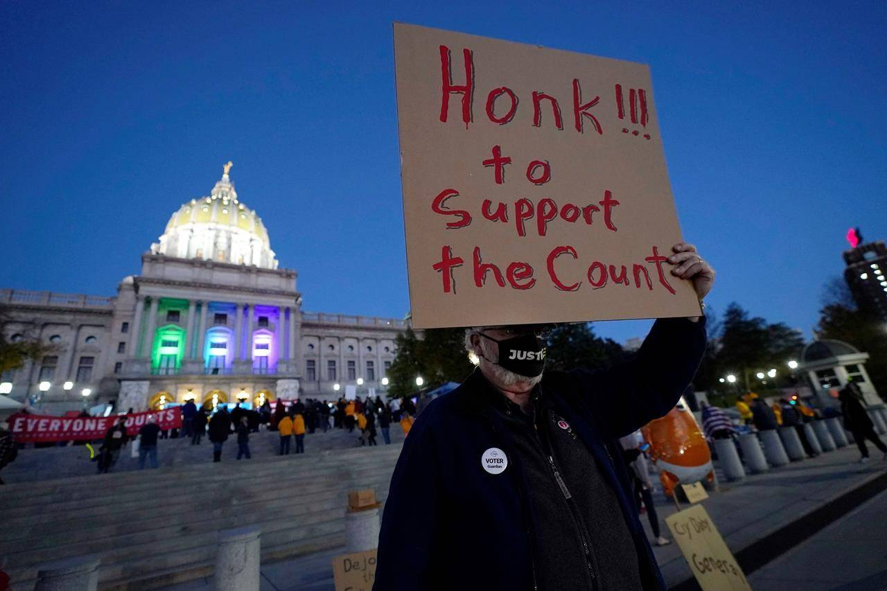 Keith Bentz joins others demonstrating outside the Pennsylvania State Capitol to urge that all votes be counted, Wednesday, Nov. 4, 2020, in Harrisburg, Pa., following Tuesday's election. (AP Photo/Julio Cortez)