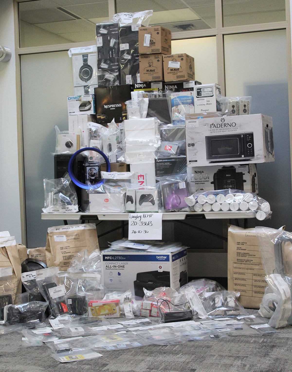 The Langley RCMP released a photo of items seized from a home in Willloughby on Oct. 30, 2020. (Langley RCMP)