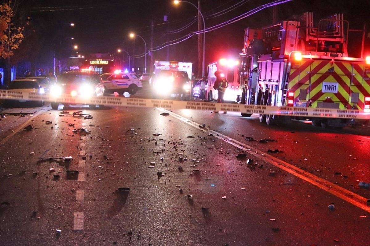Scene of a traffic crash in Whalley that sent a Transit Police officer and another person to hospital late Wednesday night. (Photo: Shane MacKichan)