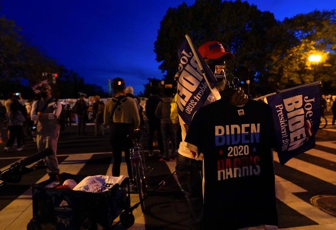 A vendor sells t-shirts supporting Democratic presidential candidate Joe Biden, Thursday, Nov. 5, 2020, in Washington. (AP Photo/Jacquelyn Martin)