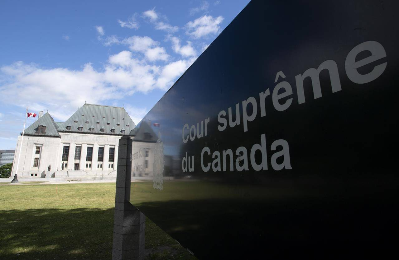 Clouds pass by the Supreme Court of Canada in Ottawa, Friday June 12, 2020. The Supreme Court of Canada says only people, not corporations, benefit from the charter protection against cruel and unusual punishment. THE CANADIAN PRESS/Adrian Wyld