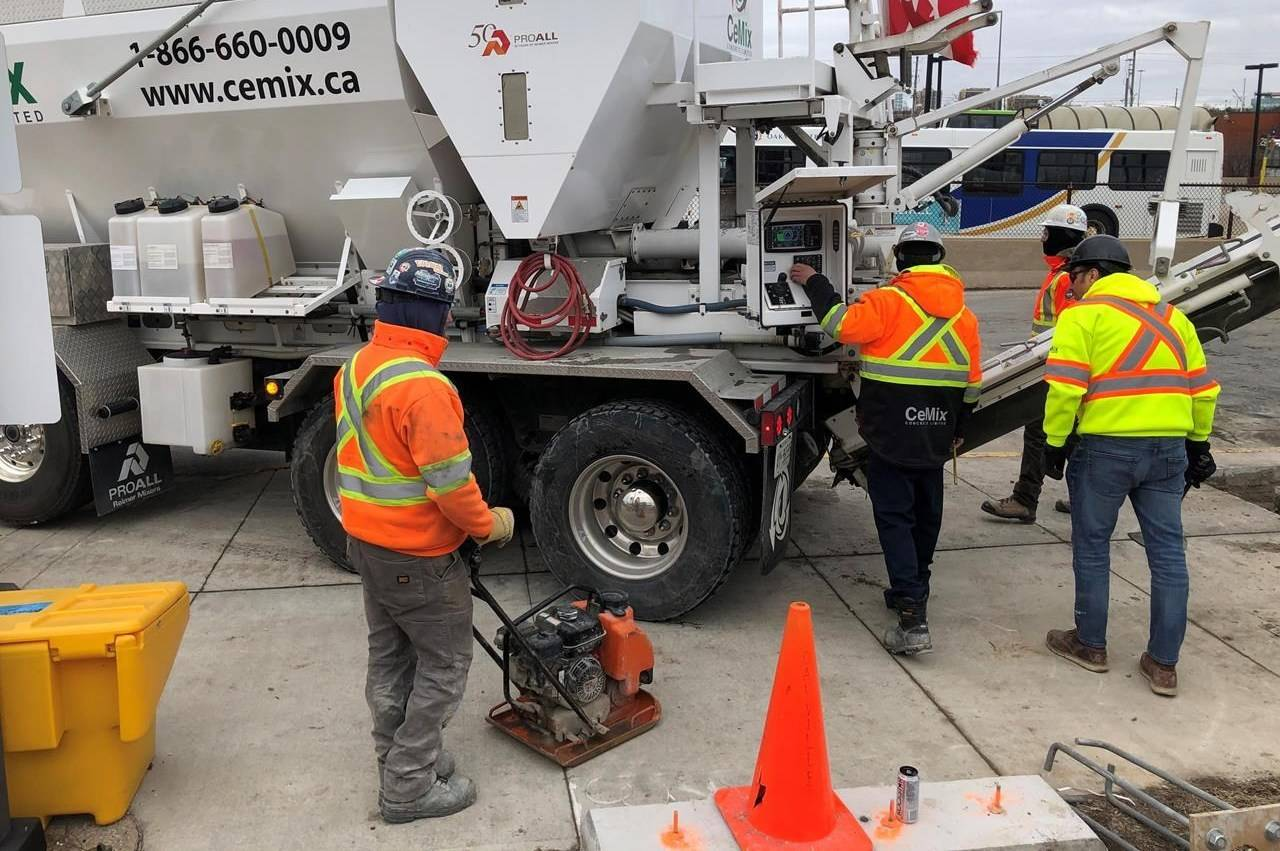 Workers get set to pour cement from a truck at the GO train station in Oakville, Ont., Tuesday, Jan.28, 2020. Statistics Canada will say this morning how the country's job market fared in October, with experts expecting the pace of gains to slow from September. THE CANADIAN PRESS/Richard Buchan