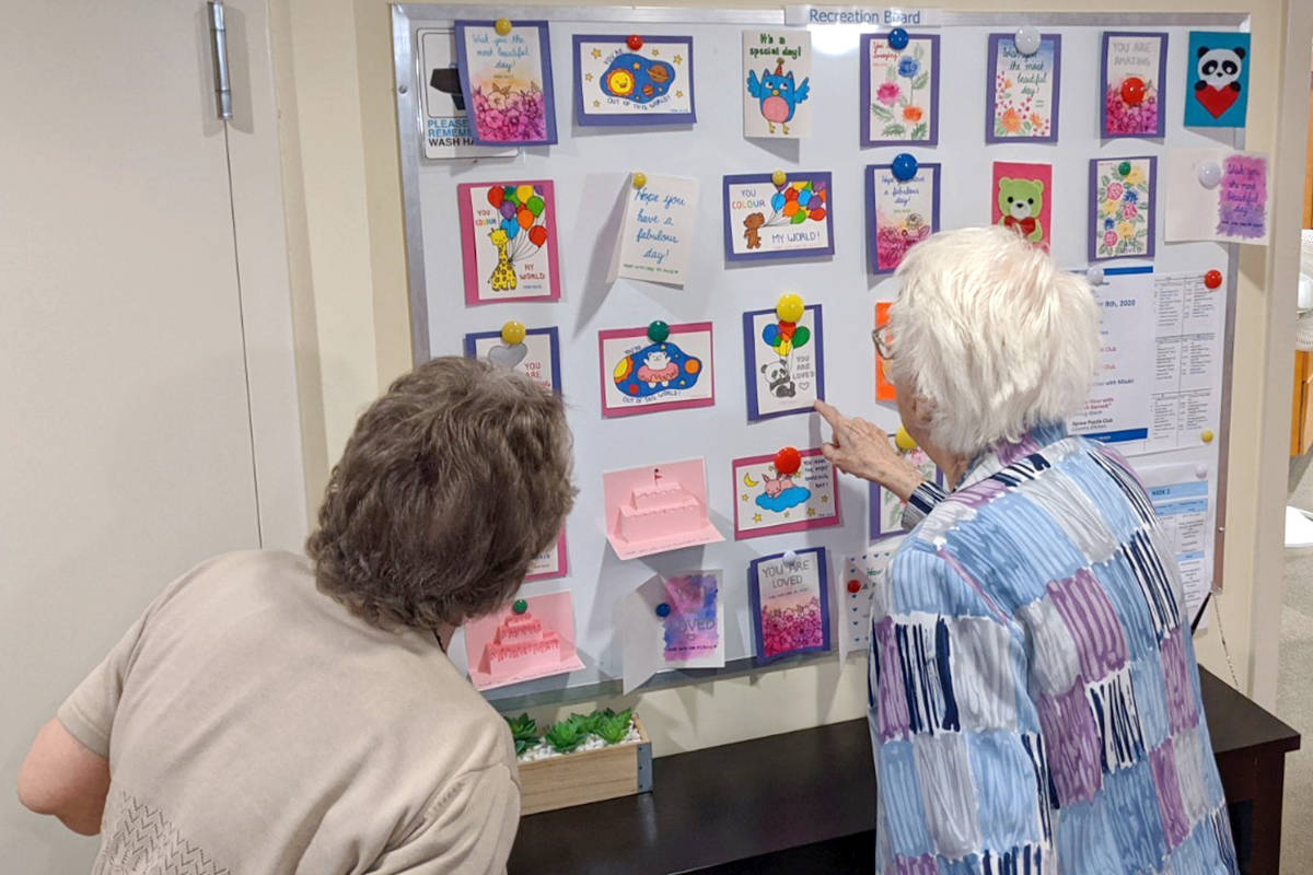 Photos taken by staff at Langley Seniors Village show admirers of handmade cards created by R.E. Mountain Secondary students and other volunteers for local seniors who are isolated due to pandemic restrictions. (Alice He/Special to Langley Advance Times)