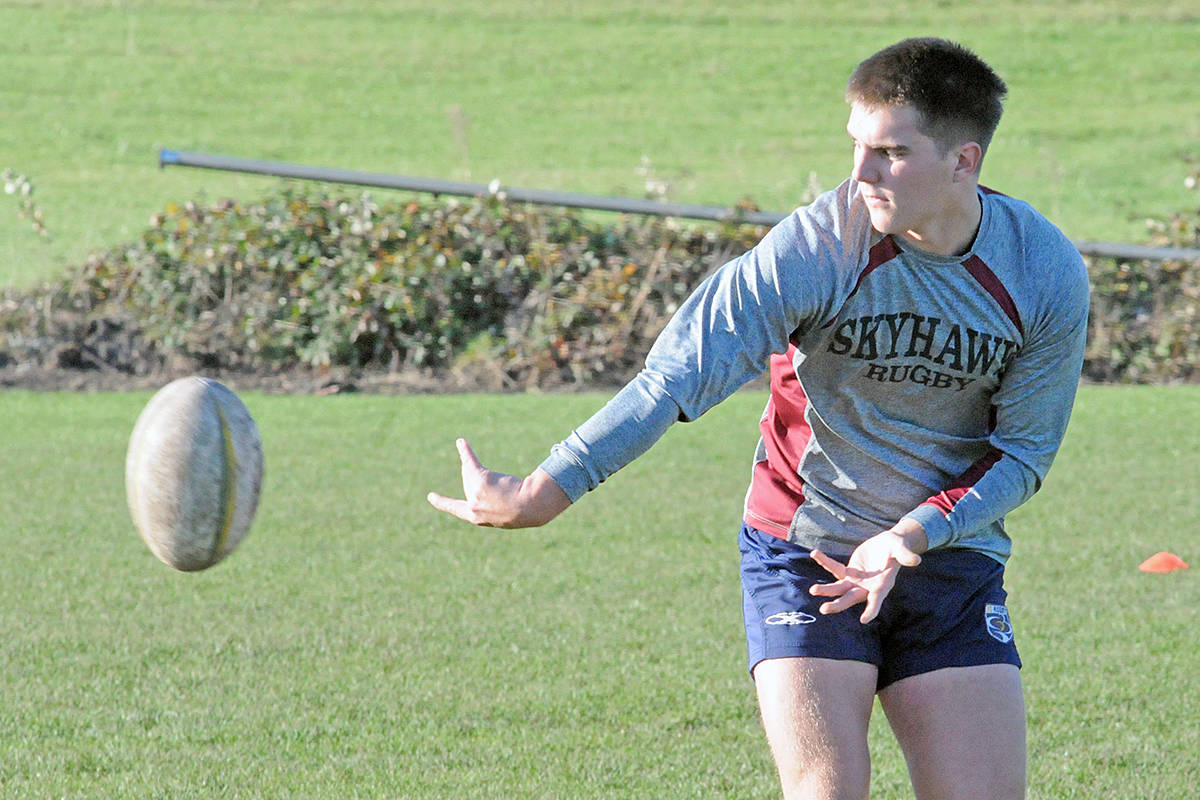 A Langley Rugby player makes a side pass during a practice at the Crush Crescent field on Sunday, Nov. 8, 2020 (Dan Ferguson/Langley Advance Times)