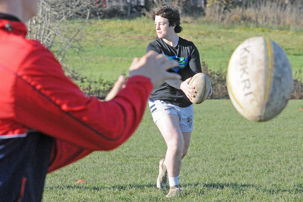 Langley Rugby players practice their passes at a non-contact practice at the Crush Crescent field on Sunday, Nov. 8, 2020 (Dan Ferguson/Langley Advance Times)