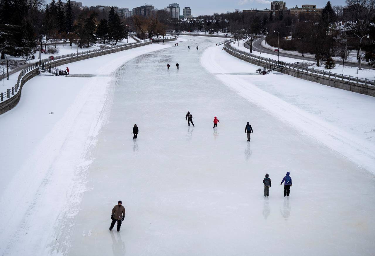 Skaters makes their way along the Rideau Canal Skateway in Ottawa on the opening day of its 50th season, on Saturday, Jan. 18, 2020. From manufactured rinks in city parks, to lengthy swaths of iced-over rivers, Canada's outdoor public skating spaces may prove popular during the first full winter of the COVID-19 pandemic. THE CANADIAN PRESS/Justin Tang