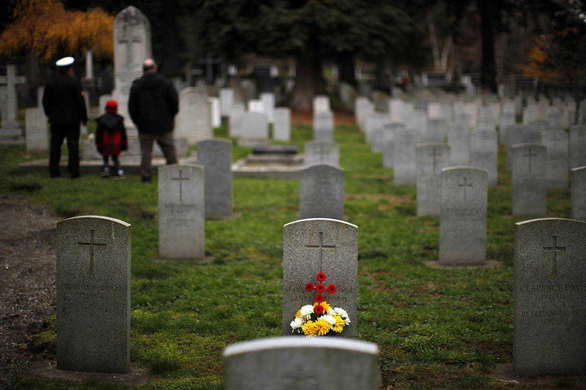 People gather to honour the fallen during a Remembrance Day ceremony at God's Acre Veteran's Cemetery in Victoria, B.C., on Monday, November 11, 2019. THE CANADIAN PRESS/Chad Hipolito