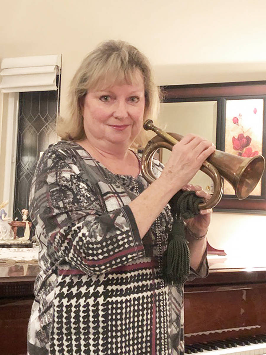 When she plays the Last Post and Rouse on Remembrance Day, Langley teacher Donna Cieszecki uses the bugle that belonged to her grandfather, Sgt. Major John ( Jock) Ingles (special to Langley Advance Times)