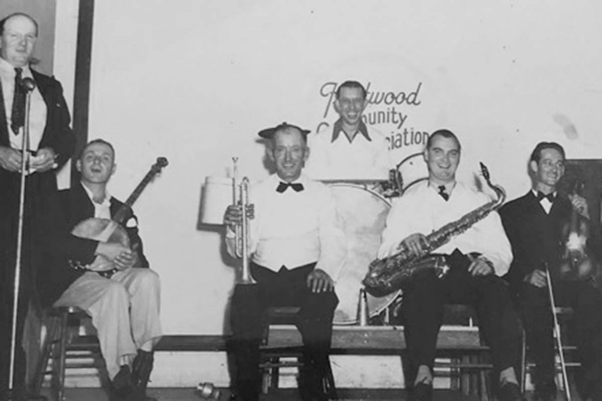 Veteran of both world wars, John ( Jock) Ingles, is seen here with his trumpet (centre), smiling with one of the bands he played in (special to Langley Advance Times)