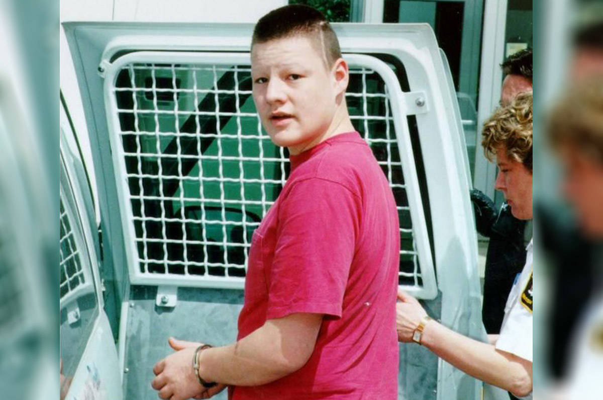 Adam Laboucan, pictured being escorted outside court in B.C. on June 18, 1999, was 17 when he was handed an indeterminate prison sentence for sexually assaulting a three-month-old boy in Quesnel. Laboucan now identifies as female and has changed her name to Tara Desousa. (Ross Mitchell/Quesnel Cariboo Observer)