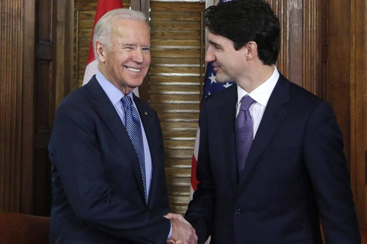 Prime Minister Justin Trudeau shakes hands with Joe Biden, then the outgoing U.S. vice-president, on Parliament Hill in Ottawa on Friday, Dec. 9, 2016. THE CANADIAN PRESS/Patrick Doyle