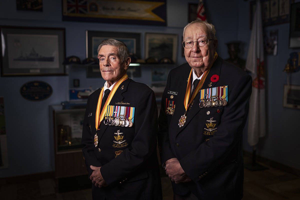 Korean War veterans Andy Barber, right, and Ron Kirk, pose for a picture at the Halton Naval Veterans Association Burlington, Ont. on Friday November 6, 2020. Barber and Kirk served in the navy as part of a peacekeeping force immediately following the armistice in July 1953. THE CANADIAN PRESS/Mark Blinch
