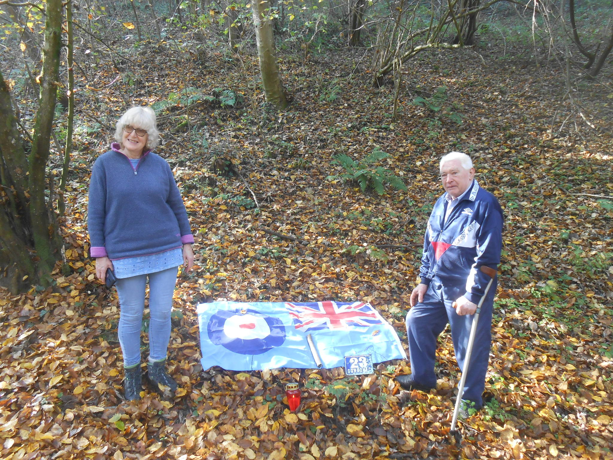 Heather Maling and Zvonko with a flag and candle at the crash site. Photo: Submitted