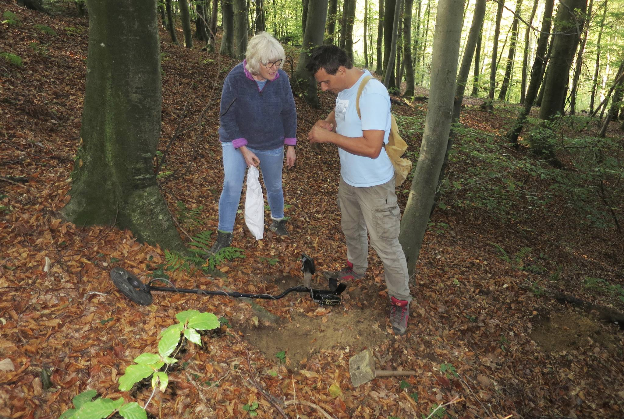 Heather Maling and crash researcher Radovan Zivanovic searching for small pieces from the crash site where Officer Henry Carruthers, of Trail, was killed in the Second World War. Photo: Submitted