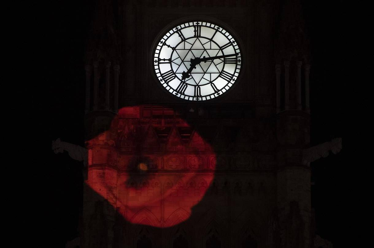 A poppy is projected on the side of the Peace Tower in Ottawa, Monday, Nov. 9, 2020. On the eve of Remembrance Day, the federal Liberal government is moving ahead with plans to provide emergency assistance to veterans organizations that have been battered by the COVID-19 pandemic. THE CANADIAN PRESS/Adrian Wyld