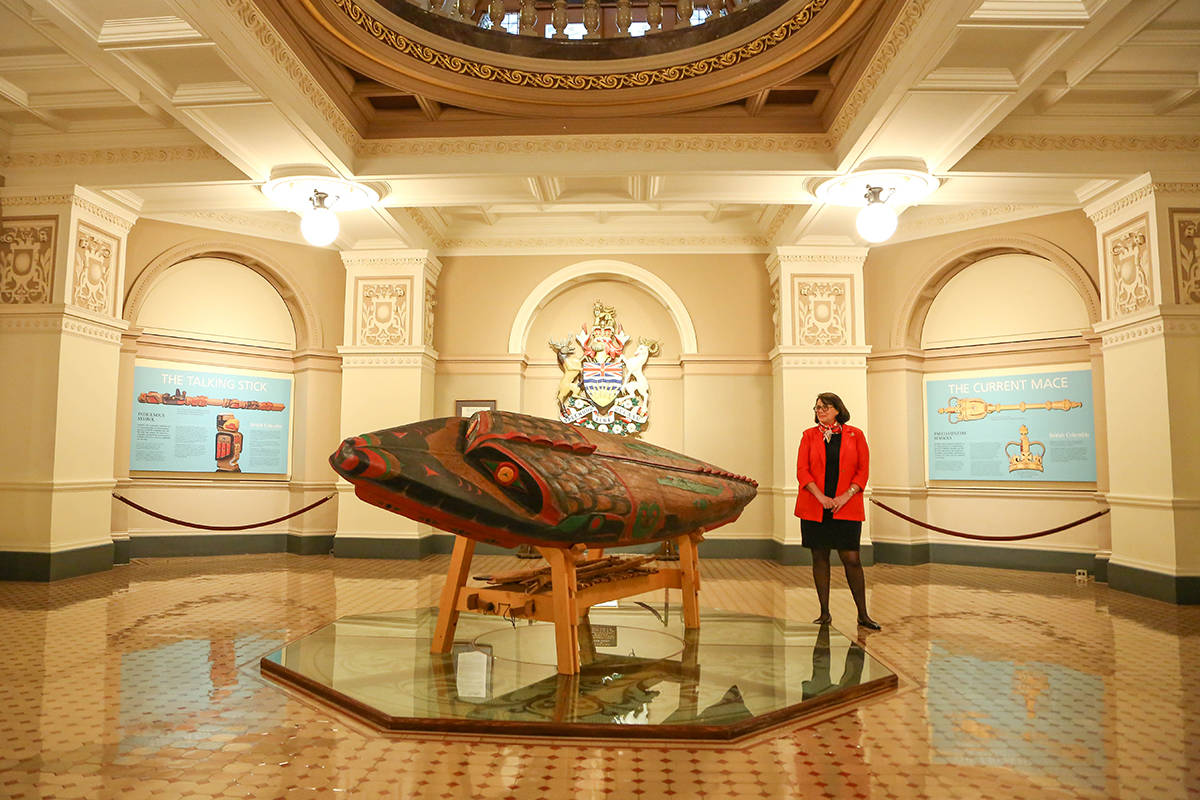 "Janet Austin, lieutenant governor of British Columbia stands by a canoe carved by former lieutenant governor Steven Point. The canoe named Shxwtitostel (pronounced: Schwe-tea-tos-tel) means ""a safe place to cross the river"" in Halq'eméylem and is currently on display at the B.C. Legislature building. (Office of the Lieutenant Governor of British Columbia photo)"