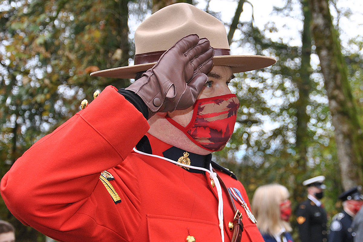 Remembrance Day 2020, Murrayville Cemetery with invite only attendees participating in a livestreaming service, including committee member and RCMP's Kirby Adams. (Roxanne Hooper/Langley Advance Times)