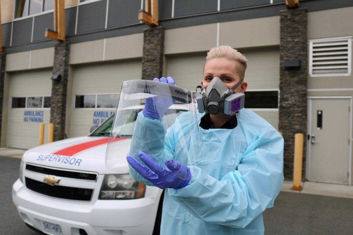 B.C. Emergency Health Services primary care paramedic Em Funk shows off the personal protective equipment their team uses whenever they are dealing with a suspected case of COVID-19 while on the job. (Aaron Guillen/News Staff)
