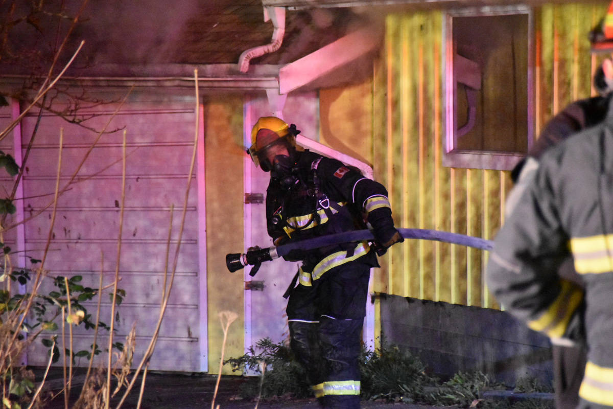Firefighters battled a fire in a detached garage on the Willoughby Slope on Crush Crescent the night of Wednesday, Nov. 11. (Curtis Kreklau South Fraser News Service/Special to the Langley Advance Times)