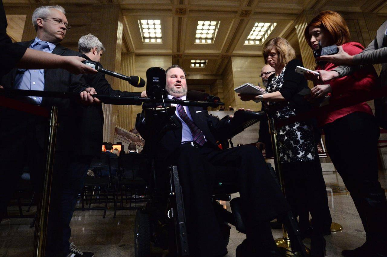 Conservative MP Steven Fletcher talks with reporters in the foyer of the Supreme Court of Canada in Ottawa on Wednesday October 15, 2014. THE CANADIAN PRESS/Sean Kilpatrick