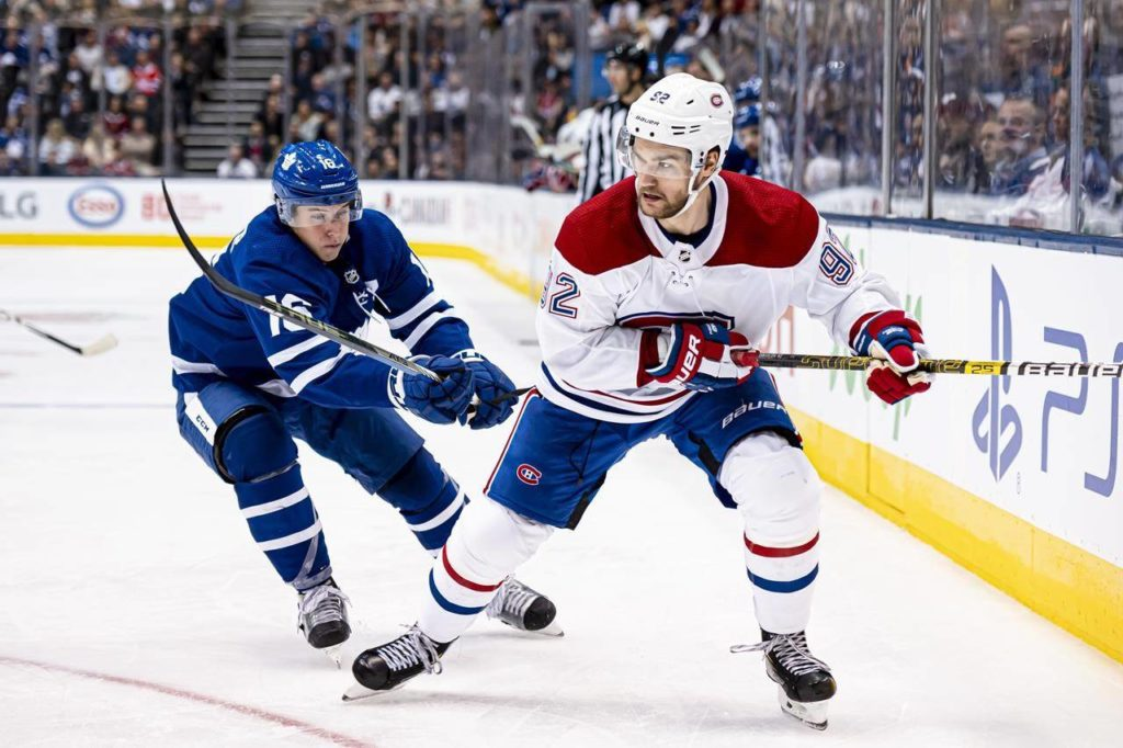 Montreal Canadiens left wing Jonathan Drouin (92) is defended by Toronto Maple Leafs right wing Mitchell Marner (16) during third period NHL hockey action, in Toronto on October 5, 2019. THE CANADIAN PRESS/Christopher Katsarov