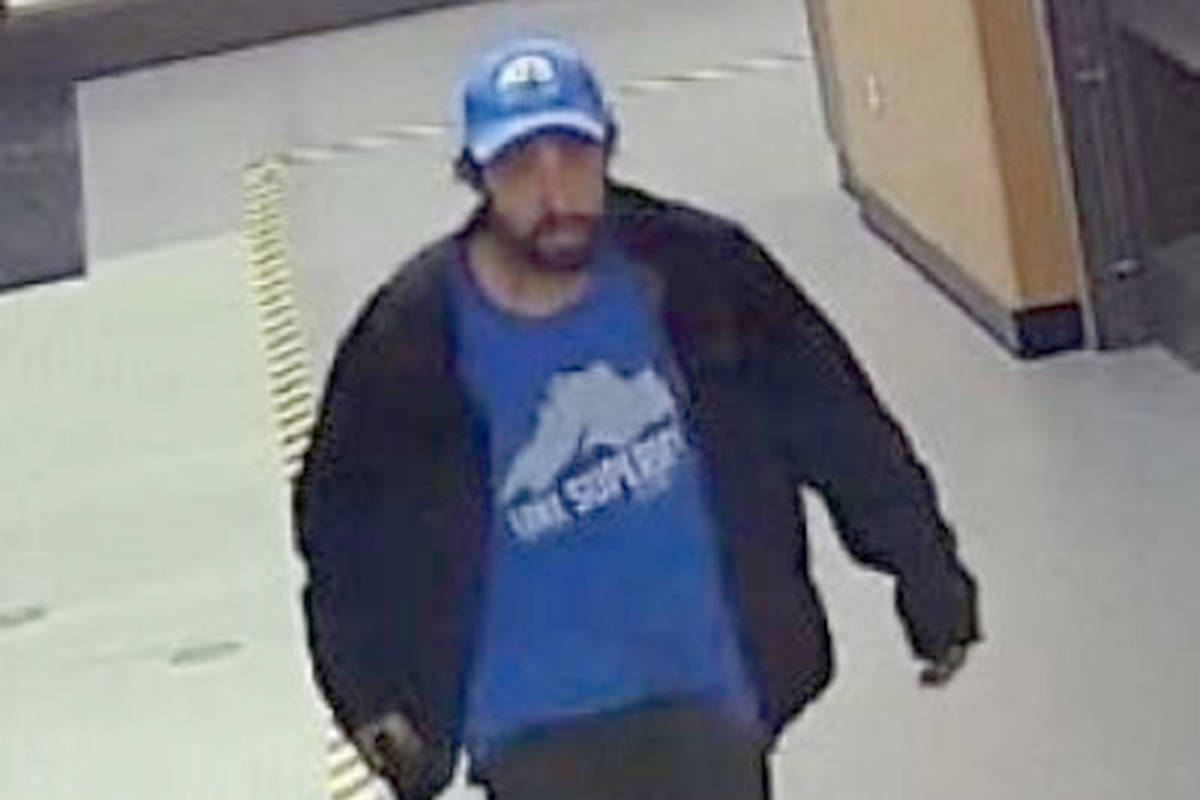 RCMP say this man entered Langley Secondary during parent teacher night and made off with a laptop and a coffee maker. (Langley RCMP/Special to the Langley Advance Times)