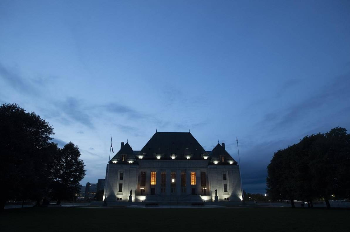 The Supreme Court of Canada is seen at sunset in Ottawa, Tuesday September 1, 2020. THE CANADIAN PRESS/Adrian Wyld