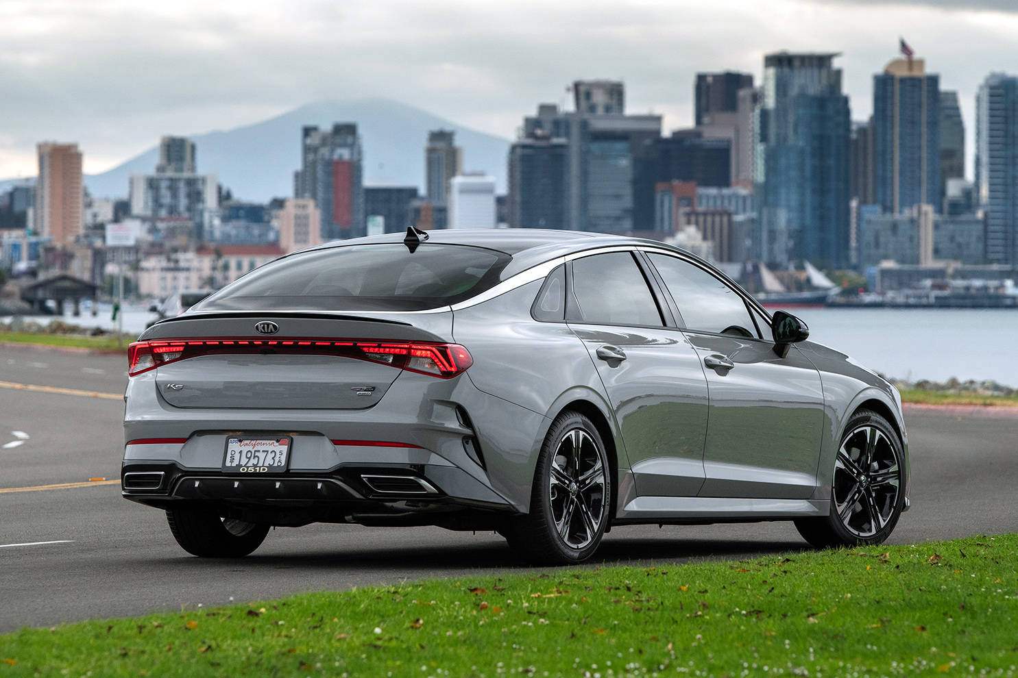 The K5's styling is highlighted by a band of trim that extends above the front door glass, wrapping around the base of the rear window. The full-width taillights are also quite striking. PHOTO: KIA