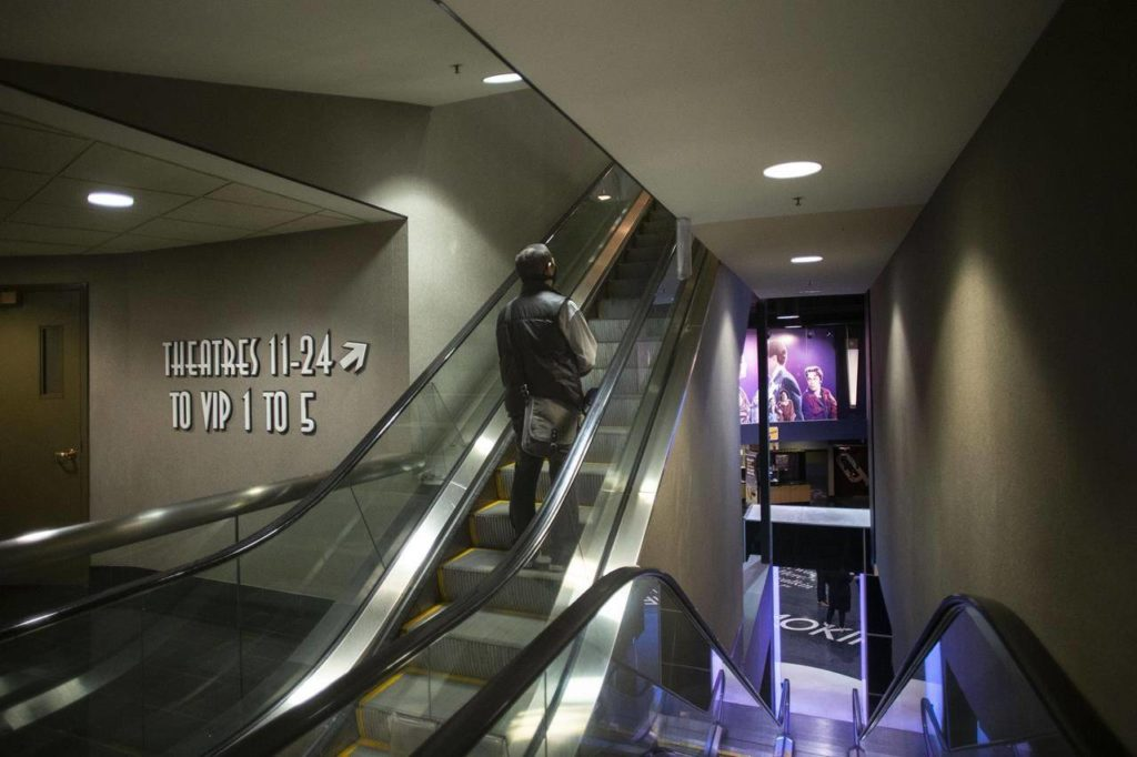 A movie goer makes his way to a theatre at a Cineplex in Toronto, on Tuesday, October 6, 2020. THE CANADIAN PRESS/Chris Young