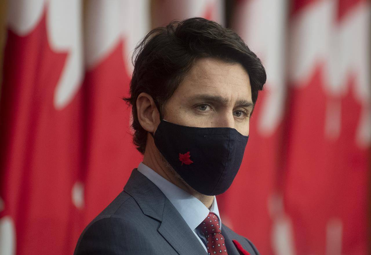 Prime Minister Justin Trudeau listens to a Minister speak via video conference during a news conference in Ottawa, Tuesday November 10, 2020. THE CANADIAN PRESS/Adrian Wyld