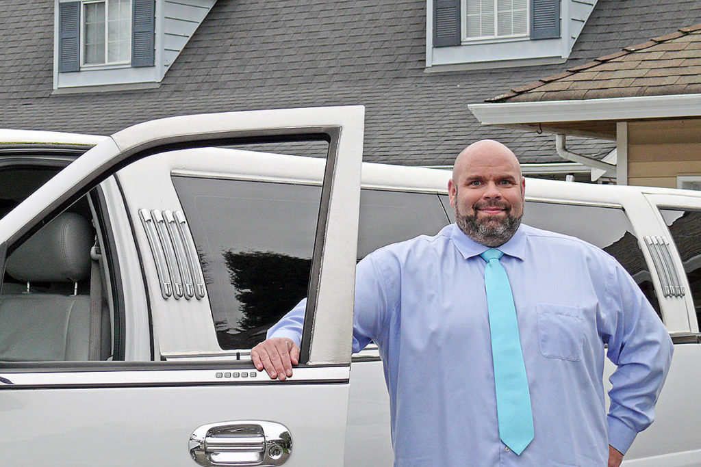 Shawn Stiles, owner of Inifinity Limousine, seen here with one of his stretch SUVS on Saturday, Nov. 14, 2020, said there has been a lack of clarity about COVID-19 rules for the industry (Dan Ferguson/Langley Advance Times)
