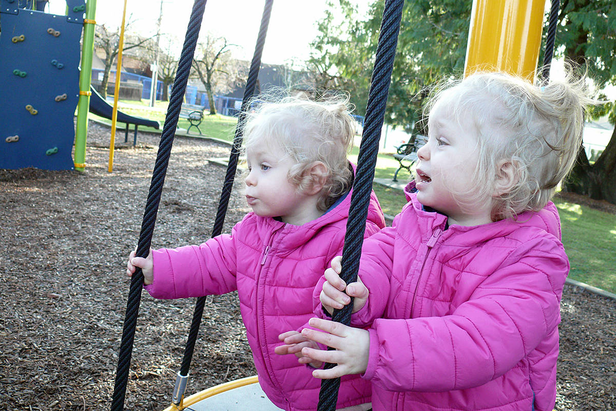 Twin sisters Kalli (L) and Kylie Eccles tried out the merry-go-round at Brydon Park, located on the corner of 53 Avenue and 198 Street in Langley City, on Sunday Nov. 15 (Dan Ferguson/Langley Advance Times)