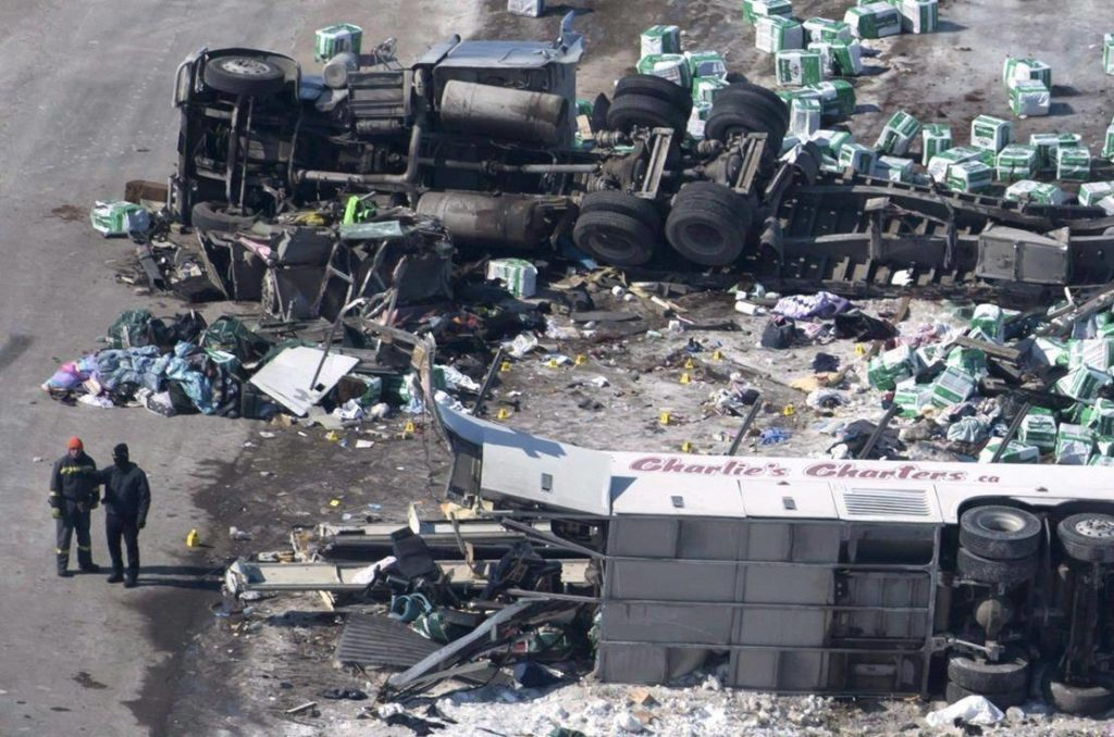 The wreckage of a fatal crash involing the Humboldt Broncos hockey team bus outside Tisdale, Sask., is seen on Saturday, April, 7, 2018. A number of Broncos parents are angry there has been little action on seatbelts on buses since the crash that killed 16 people and injured 13. THE CANADIAN PRESS/Jonathan Hayward