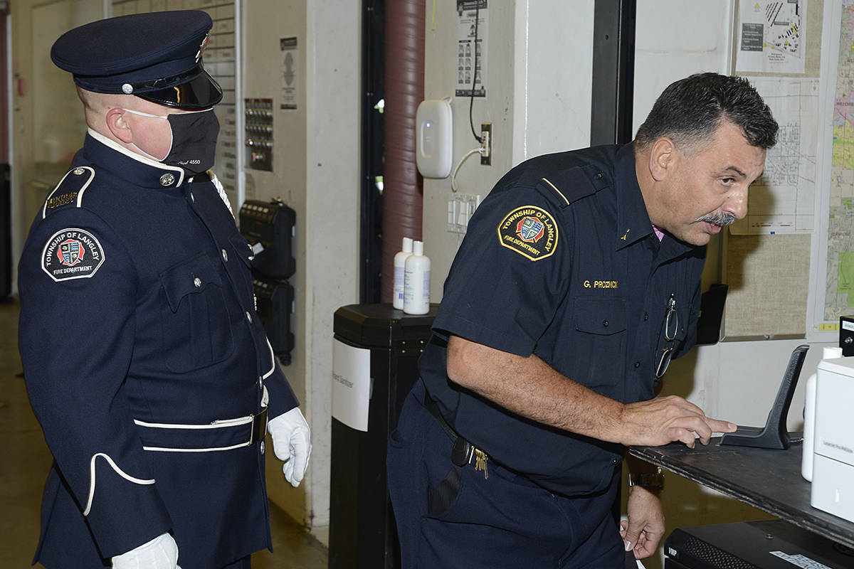 Public education officer Gary Proznick answered a retirement tribute from fire dispatch during his walk-out ceremony at the Murrayville firehall on Oct. 30. (Jhim Burwell/Special to Langley Advance Times)