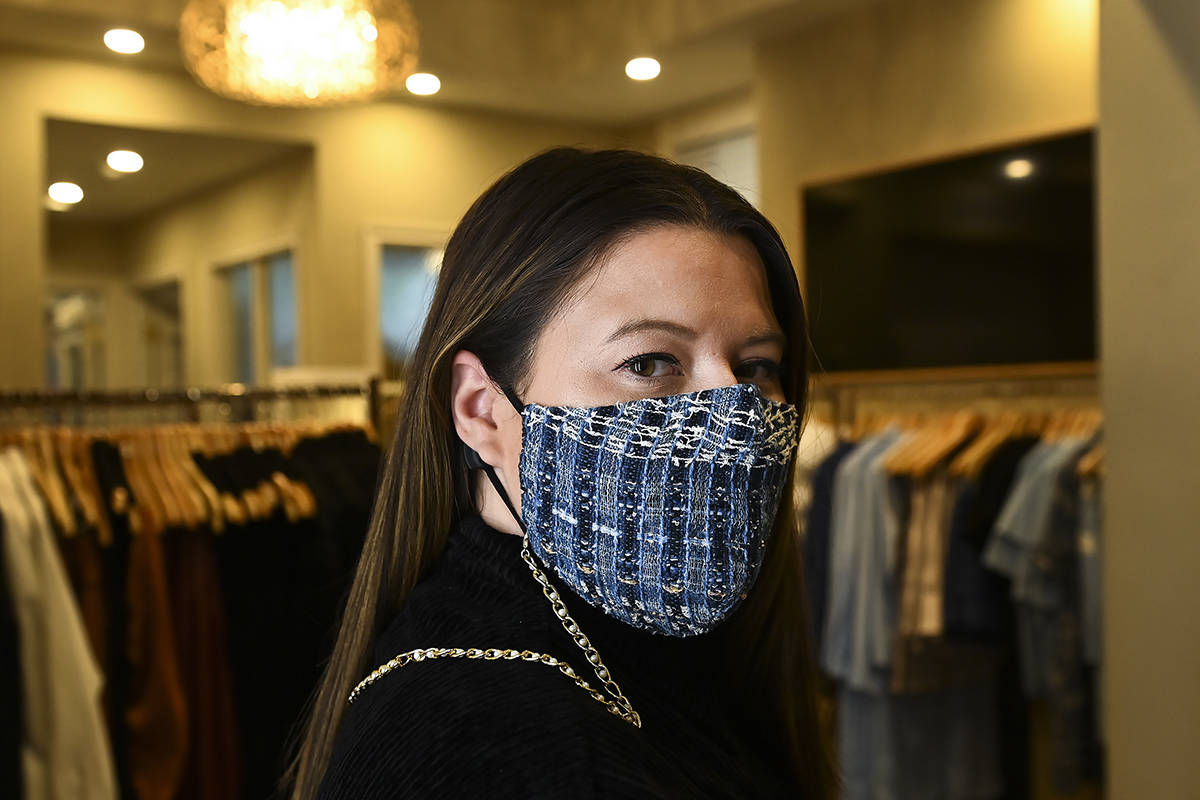 Toronto clothing designer Hilary MacMillan poses for a photograph wearing her self-designed mask chains at her studio in Toronto, Thursday, Oct. 15, 2020. MacMillan is adapting to the COVID-19 pandemic selling masks and mask accessories. THE CANADIAN PRESS/Nathan Denette