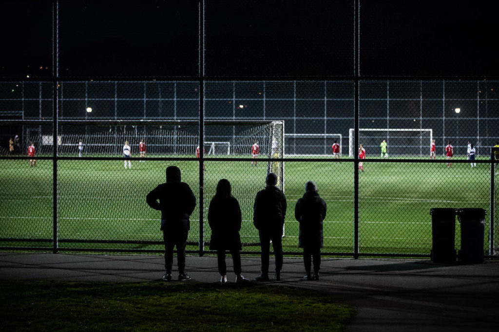 People watch a youth soccer match, in Burnaby, B.C., on Saturday, November 7, 2020. B.C. public health orders banning social gatherings are in effect Nov. 7-23, 2020. THE CANADIAN PRESS/Darryl Dyck
