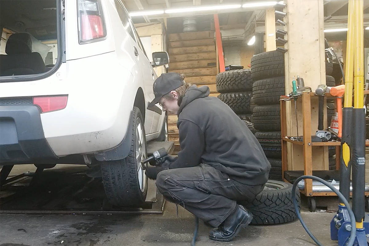 A technician changes tires at OK Tire in Langley on Tuesday, Nov. 17, 2020. Like many, the business has noticed delays in getting winter tires due to COVID-19 plant closures and delivery disruptions (Dan Ferguson/Langley Advance Times)