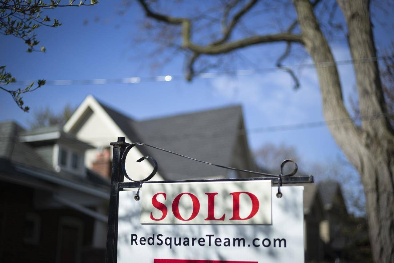 A real estate sold sign is shown in a Toronto west end neighbourhood May 17, 2020. The Canadian Real Estate Association says home sales in October edged back from their all-time record high for monthly sales they set in September. THE CANADIAN PRESS/Graeme Roy