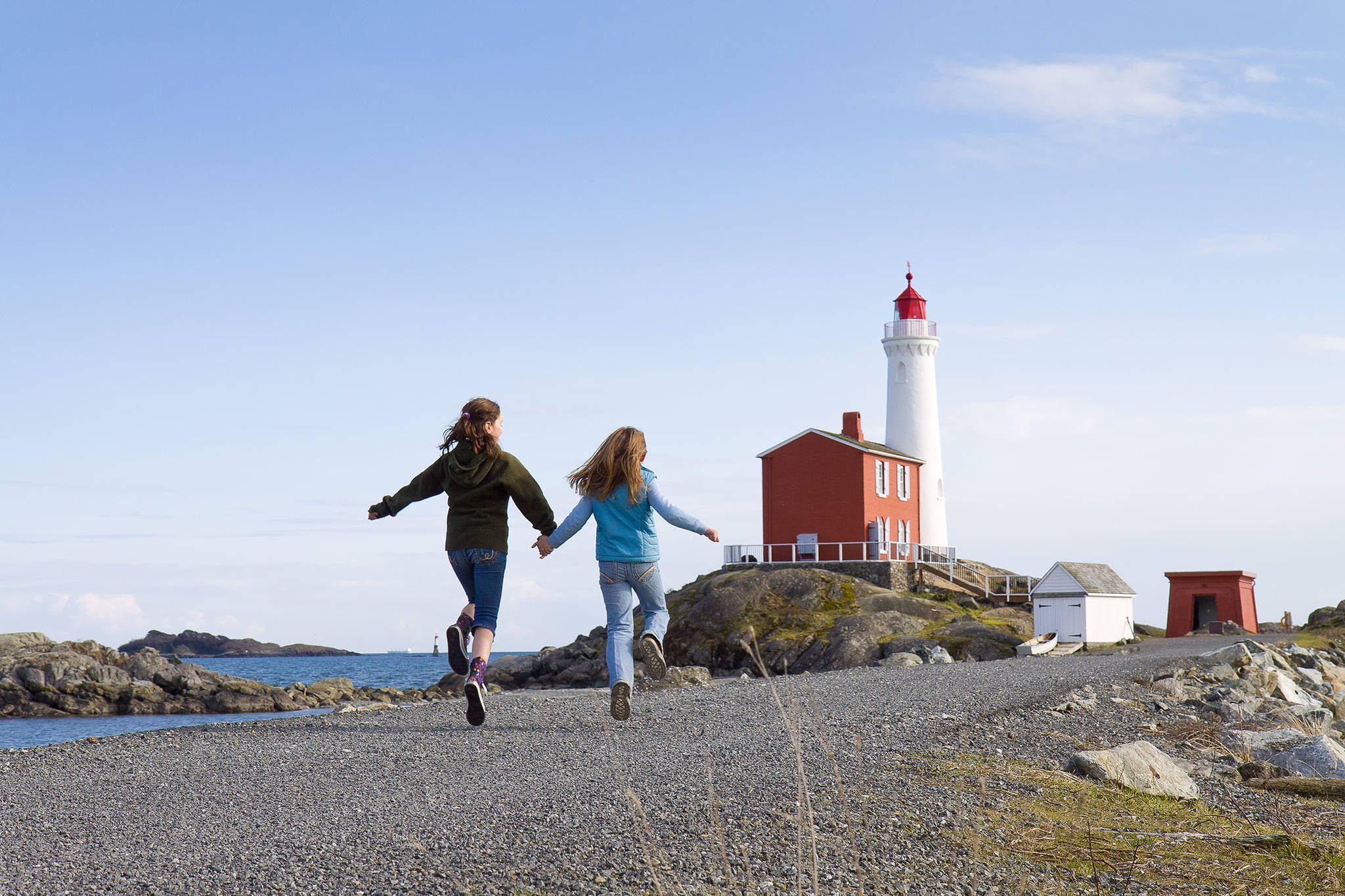Children run toward the Fisgard Lighthouse National Historic Site, which saw its 160th birthday marked on Nov. 16. (Photo courtesy of Parks Canada)