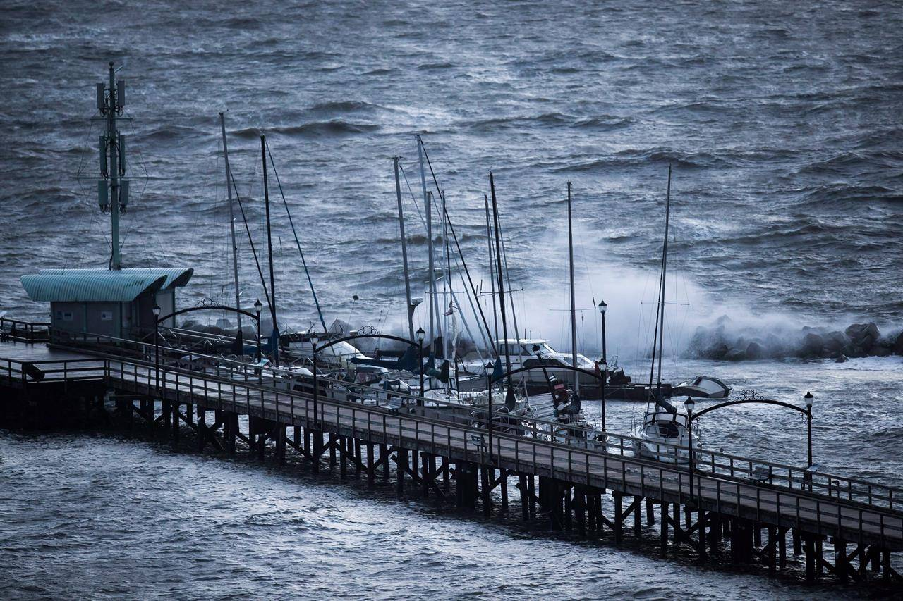 Boats are battered by waves at the end of the White Rock Pier that was severely damaged during a windstorm, in White Rock, B.C., on Thursday, December 20, 2018. Much of coastal British Columbia is braced for a brief but powerful windstorm while snowfall and winter storm warnings stretch from the inland north coast all the way to the northeast corner of the province. THE CANADIAN PRESS/Darryl Dyck