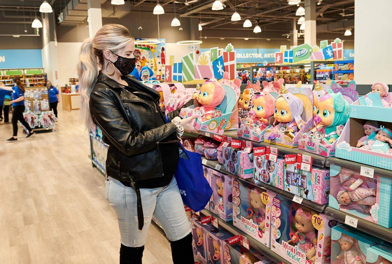 "A woman looks at toys at a Toys ""R"" Us store in Guelph, Ont. in this undated handout photo. While holiday spending is expected to be muted this year overall, toy retailers like Toys ""R"" Us are expecting strong sales as parents aim to give kids a ""normal"" holiday. THE CANADIAN PRESS/HO, Toys ""R"" Us *MANDATORY CREDIT*"