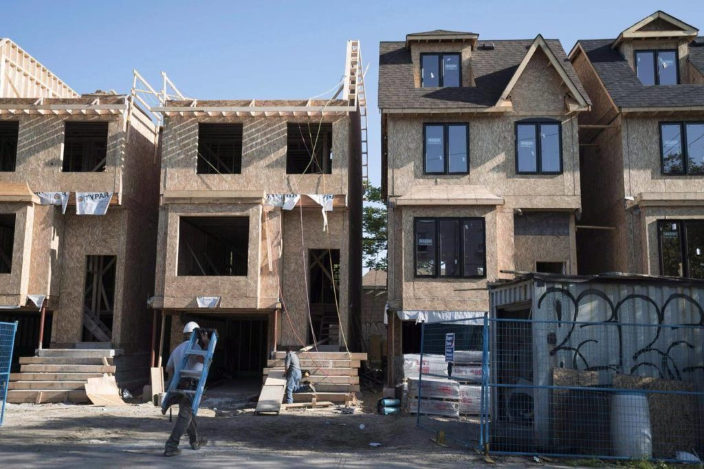 Houses under construction in Toronto on Friday, June 26, 2015. Canada Mortgage and Housing Corp. says the annual pace of housing starts increased in October. The national housing agency says the seasonally adjusted annual rate of housing starts rose to 214,875 units last month compared with 208,715 in September. THE CANADIAN PRESS/Graeme Roy