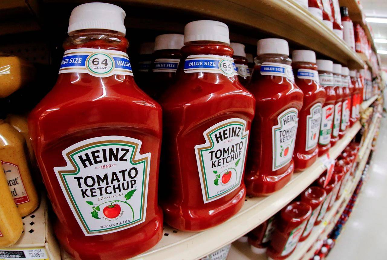 This Feb. 21, 2018, file photo shows a display of Heinz Ketchup on display in a market in Pittsburgh. Kraft Heinz says the production of Heinz Ketchup is returning to Canada, with the company's Montreal, Que., factory set to begin making the iconic condiment next summer. THE CANADIAN PRESS/AP Photo/Gene J. Puskar