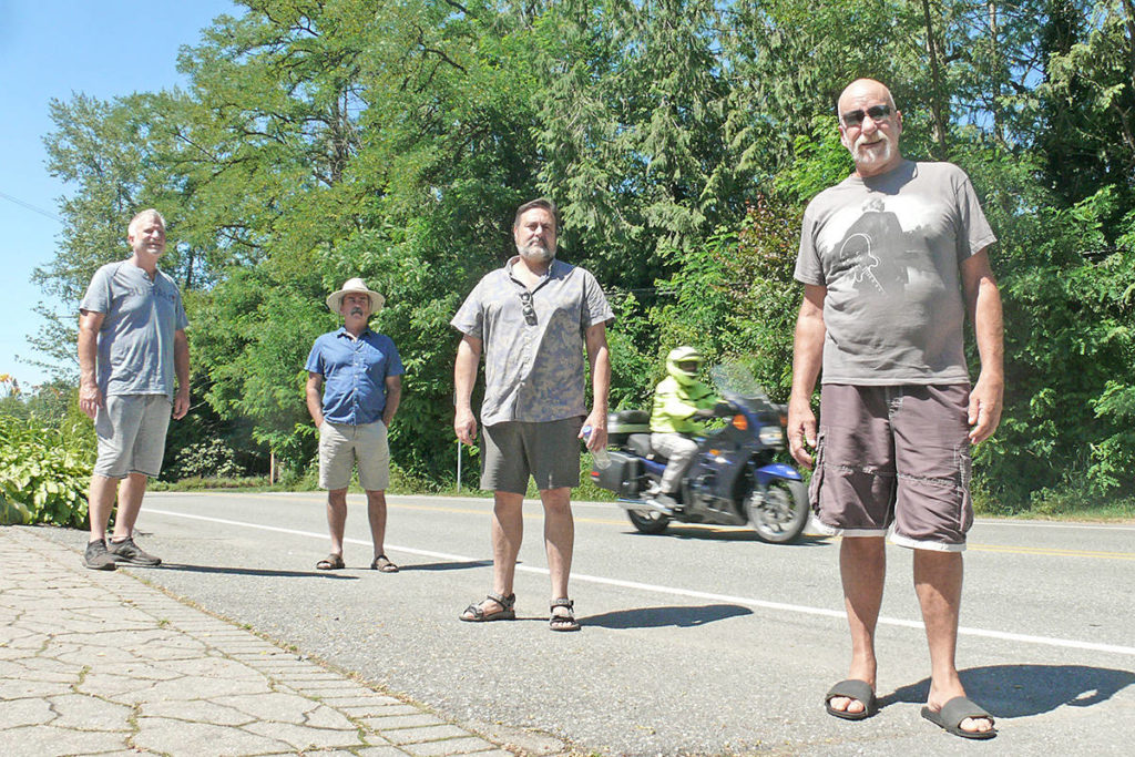 Allard Crescent neighbours (left to right) Fred Berg, Robert Symington, Rob Kugel and Greg Drew, seen here on Sunday, July 26, 2020 outside Drew's home, say increased traffic and more speeding has made the formerly quiet country lane an increased risk for accidents. They want traffic calming measures and police radar to slow vehicles down. (Dan Ferguson/Langley Advance Times)