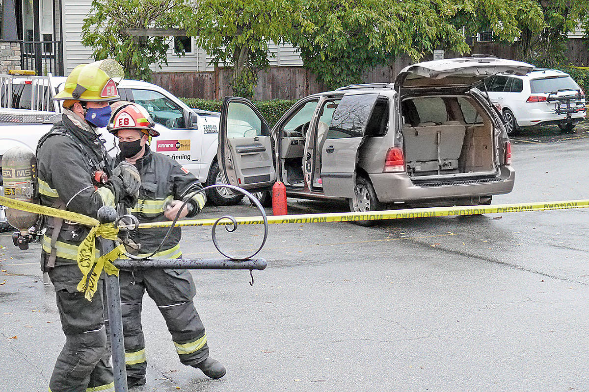 Firefighters at the scene where a burning van was sent careening, driverless, through the intersection of 88 Ave, and 216 St. on Tuesday Nov. 17, 2020. (Dan Ferguson/Langley Advance Times)